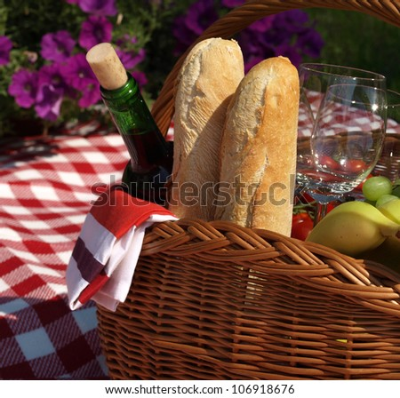 Basket with food and wine for picnic