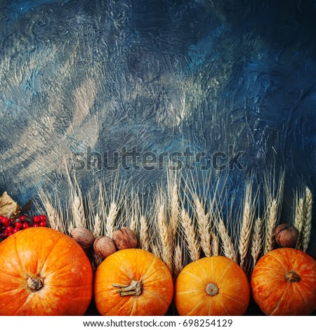 Basket with fresh apples and pears on a wooden table. Autumn background.