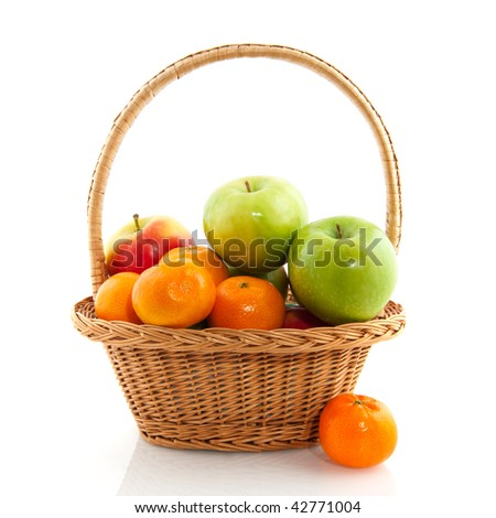 Basket with fresh apples and tangerines isolated over white