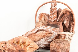 basket with fresh beautiful wicker bread on a white background for an appetizing bakery