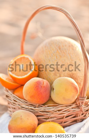 basket with fruit on beach