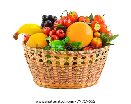 Basket with fruits (artificial) isolated on white background