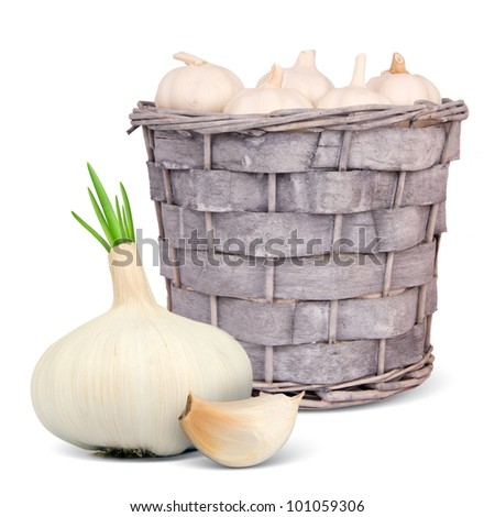 Basket with garlic isolated on white