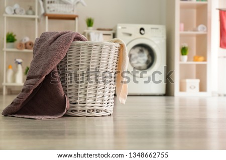 Basket with laundry in room #1348662755