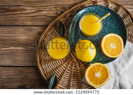 Basket with natural and fresh orange juice