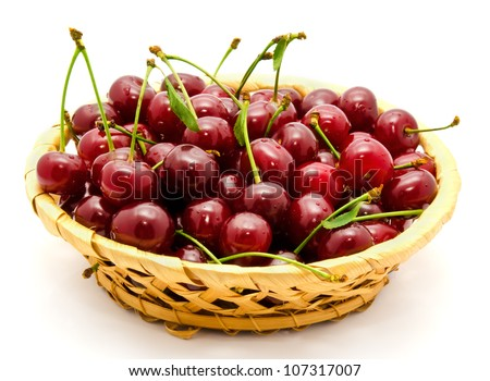 Basket with ripe wet cherry isolated on a white