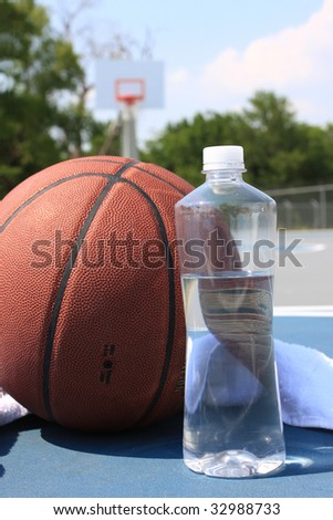 Basketball and bottled water on basketball court