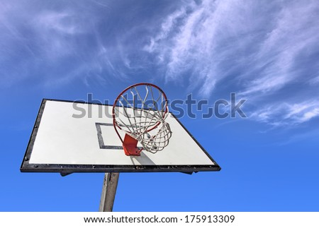 Basketball backboard on the school basketball court under blue sky