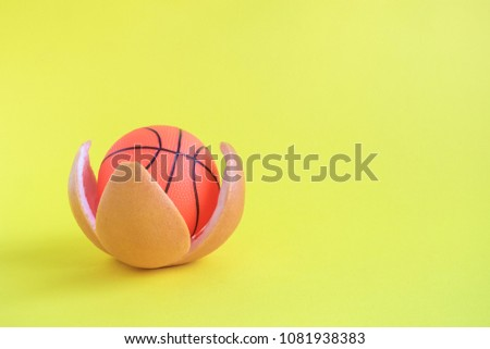 Basketball ball in orange peel on blue background. Sport and healthy lifestyle minimal concept. Space for copy. #1081938383
