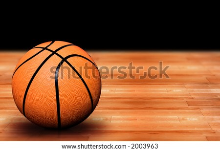 basketball ball on a court - wooden floor you can see the reflection of the ball on the wood - high resolution photo not a 3d render