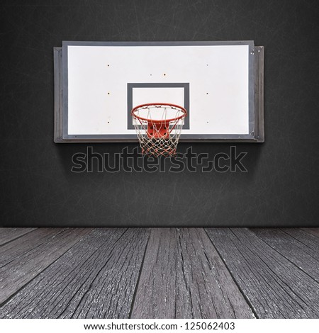 Basketball board on blackboard background with ground of the wood