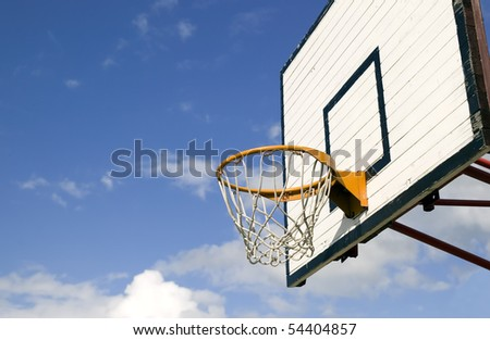 Basketball board on cloudy blue sky background