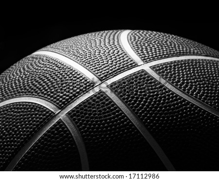 Basketball Closeup low key image of a black and white basketball and its textures