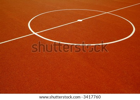 basketball court with a red rubber floor