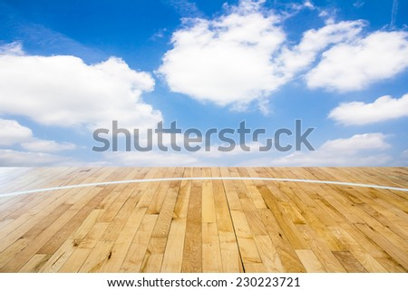 Basketball court with blue sky