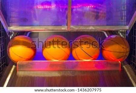 Basketball game in the game center(game room) #1436207975