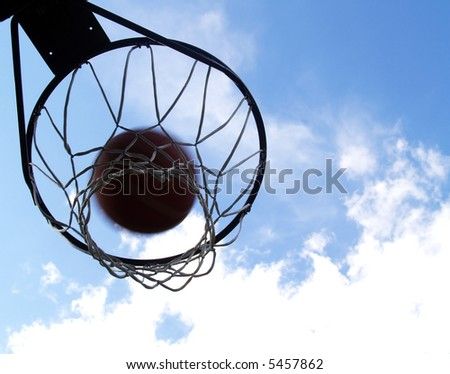 basketball going through an outdoor basketball hoop