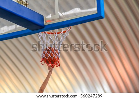 basketball going through the...