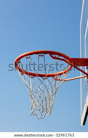 Basketball hoop against blue skies with backboard. Concept shot of aim, destination, goal, target