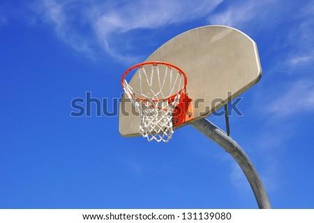 Basketball hoop blue sky room for copy space