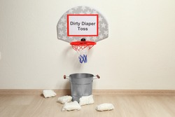 Basketball hoop, bucket and diapers for game at baby shower party