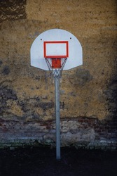Basketball hoop in urban areas on wall background