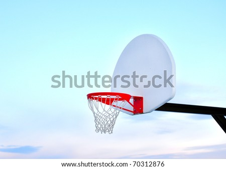Basketball hoop with blue sky and copy space