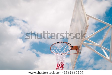 Basketball hoop with blue sky background, outdoor , street sport or recreation #1369662107