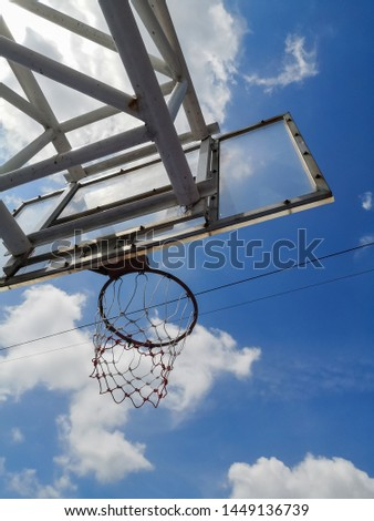 Basketball hoops on sunny and cloudy days. #1449136739