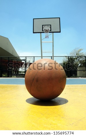 Basketball in outdoor basketball court on blue sky with daylight