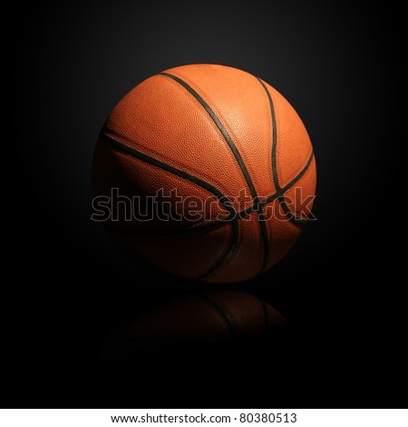 Basketball isolated on black background with light effect and reflection
