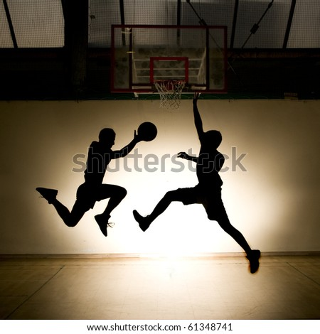 Basketball jump - black silhouettes