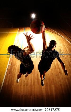 Basketball jump - dark silhouettes