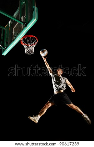 Basketball jump isolated on black background