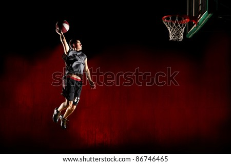 Basketball jump isolated on black red background - stock photo