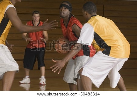 Basketball match on indoor court
