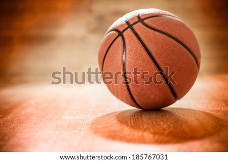 Basketball on a court floor as a sports and fitness