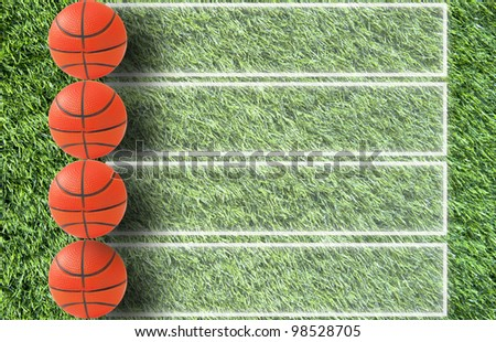 Basketball on grass and  paper background
