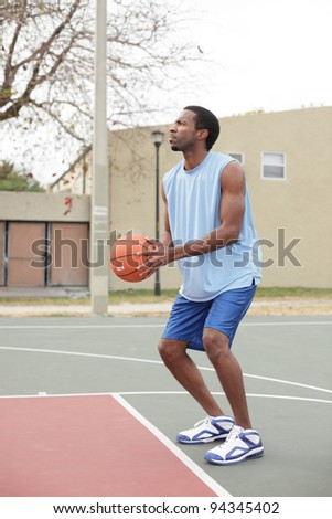 Basketball player about to throw the ball