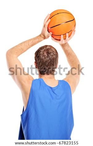 Basketball player aiming to shoot a ball isolated on white background