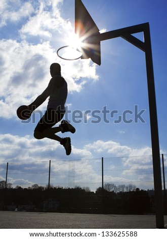 Basketball Player Dunk Silhouette