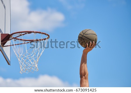 Basketball player in action flying high and scoring
