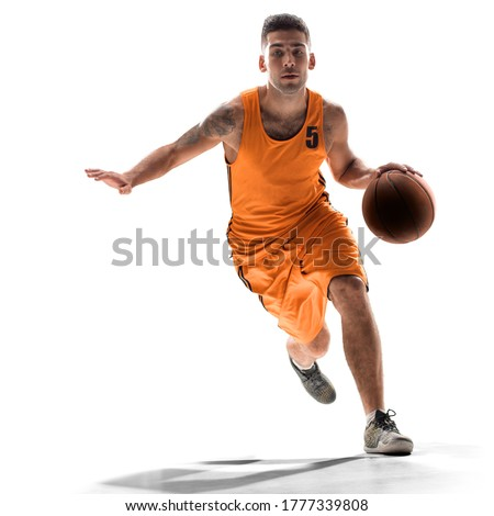 Photo of  Basketball player in action with a ball isolated on white background. Dribbling