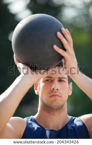 Basketball player on the outdoor basketball court