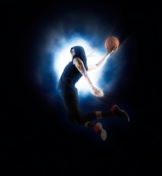 Basketball player players in action. Basketball on lightning background. Concept with copy space