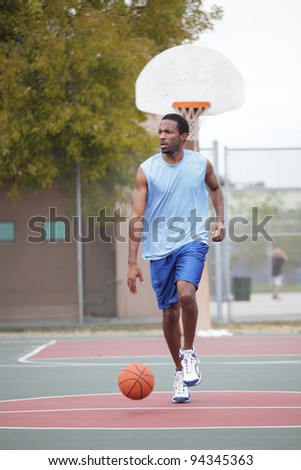 Basketball player running with the ball