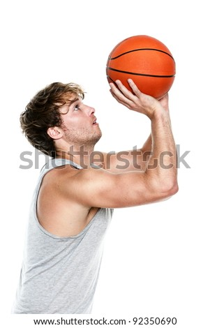 Basketball player shooting isolated on white background. Muscular fit young Caucasian sport fitness model in his 20s.