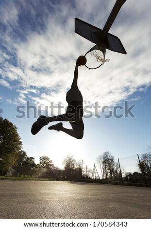 Basketball Player Slam Dunk SIlhouette