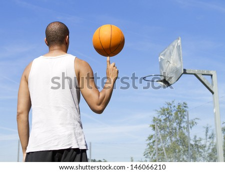 Basketball Player Spinning the Ball - stock photo