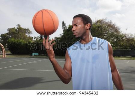 Basketball player spinning the basketball
